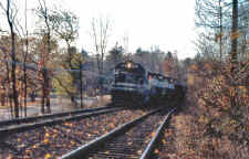 lirr251-worktrain_west-of station-smithtown_viewW_Fall1988_JohnVolpi.jpg (115249 bytes)